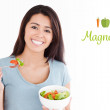 Woman eating a bowl of salad — Stock Photo #69058433