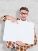 Geeky hipster smiling and showing card — Stock Photo
