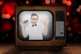 Geeky hipster holding a retro tape cassette — Stock Photo