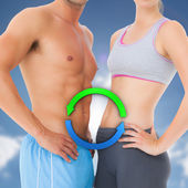 Composite image of mid section of a fit young couple — Stock Photo