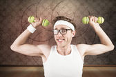 Composite image of nerd lifting weights — Stock Photo