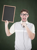 Geeky hipster holding blackboard and singing — Stock Photo