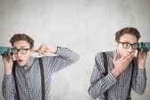 Composite image of nerd eavesdropping — Stock Photo