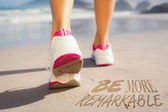 Fit woman walking on the beach — Stock Photo