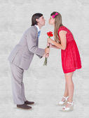 Composite image of cute geeky couple kissing — Stock Photo