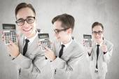 Composite image of nerd with calculator — Stock Photo