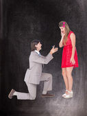 Hipster on bended knee doing a marriage proposal — Stock Photo