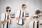 Composite image of geek with camera — Stock Photo