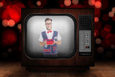 Geeky hipster offering christmas gift — Stock Photo