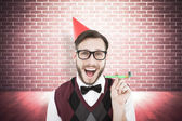 Geeky hipster in party hat with horn — Stock Photo