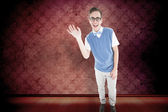 Geeky young hipster waving at camera — Stock Photo