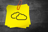 Clouds graphic against sticky note — Stock Photo