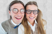 Geeky hipsters smiling at camera — Stock Photo