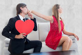 Cute geeky couple with red heart shape — Stock Photo