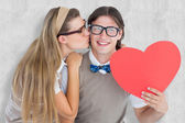 Composite image of smiling geeky hipster and his girlfriend — Stock Photo