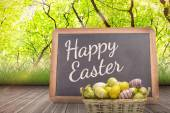 Composite image of easter eggs in basket — Stock Photo