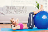 Cheerful fit blonde doing sit ups — Stock Photo