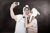 Geeky hipster couple taking selfie — Stock Photo