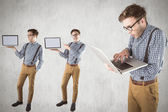 Composite image of nerd with laptop — Stock Photo