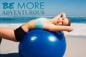 Fit woman lying on exercise ball — Stock Photo