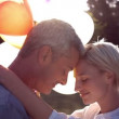 Romantic couple with balloons in park — Stock Video #69512391