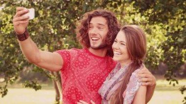 Friends taking a selfie in park — Stock Video