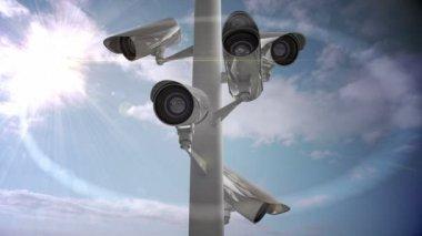 CCTV camera against blue sky — Stock Video
