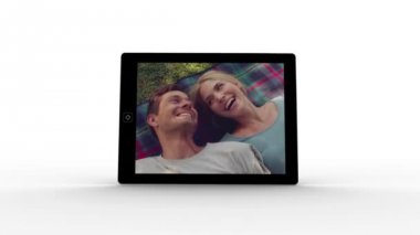 Tablet screen showing couple in love — Stock Video