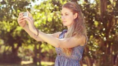 Pretty blonde girl taking a selfie — Stock Video