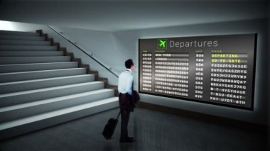 Businessman looking at departures board — Stock Video