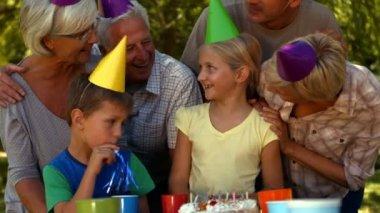 Family celebrating a birthday in park — Stock Video