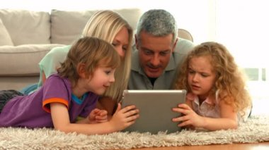 Happy family using tablet together — Stock Video