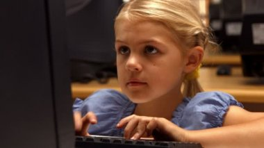 Cute pupil using computer in school — Stock Video