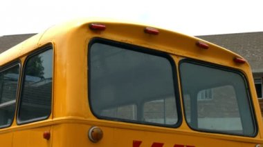 Pupils showing thumbs up by bus — Stock Video