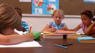 Cute pupils talking in class — Стоковое видео