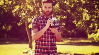 Handsome hipster boy with retro camera — Stock Video