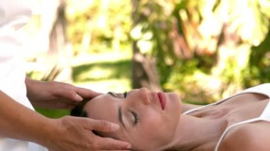 Calm woman receiving reiki treatment — Stock Video