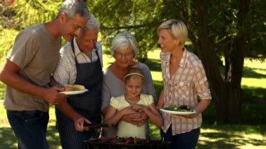 Family having barbecue in the park — Stock Video