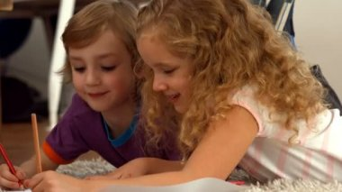 Cute siblings drawing on paper — Stock Video