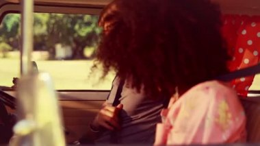 Hipster couple driving in camper van — Stock Video