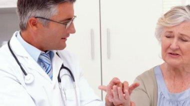 Doctor examining hand of patient — Stock Video