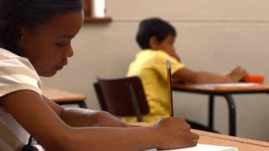 Schoolchild writing in notepad at school — Stock video
