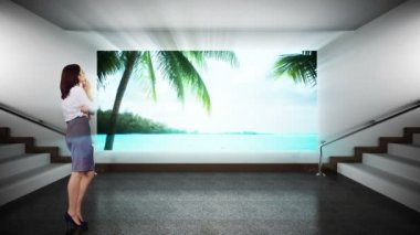 Businesswoman looking at screen showing beach paradise — Stock Video