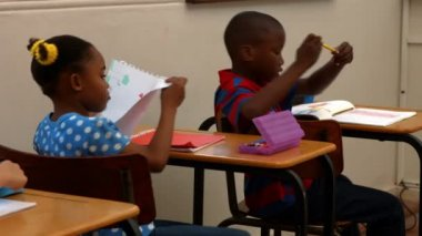 Cute schoolchildren in the classroom — Stock Video