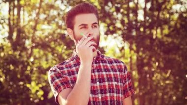 Handsome hipster boy smoking an electronic cigarette — Stock Video