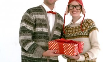 Geeky hipster couple holding present — Stock Video