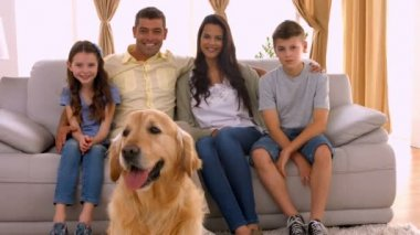 Happy family smiling with their dog — Stock Video