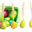 Hanging and foil wrapped easter eggs — Stock Photo #73177521