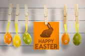 Happy Easter greeting against wooden planks — Stock Photo