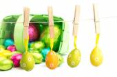 Hanging and foil wrapped easter eggs — Stock Photo